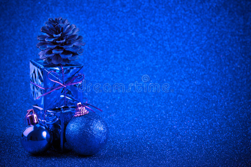 Blue christmas ball and gift decoration glitter background. Blue christmas ball and gift decoration on the glitter background royalty free stock photos