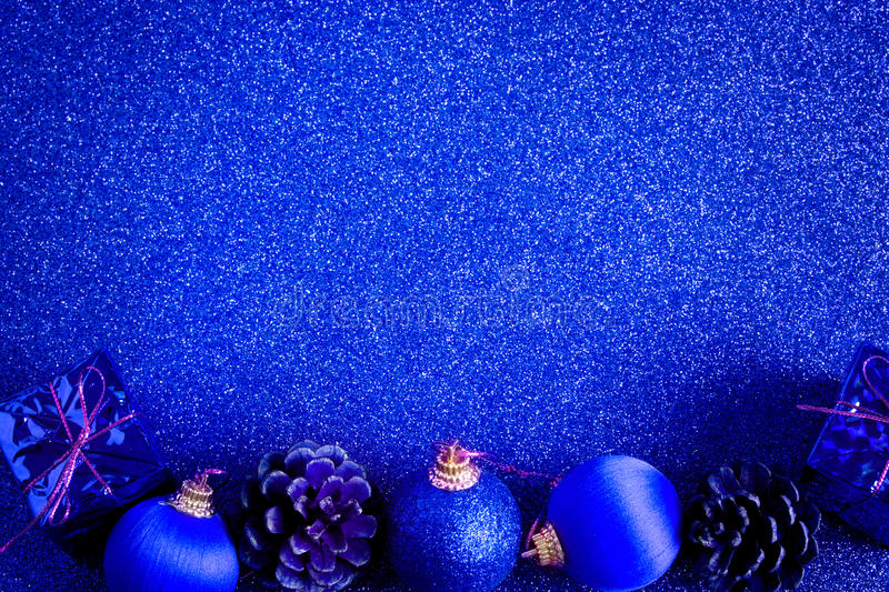 Blue christmas ball and gift decoration glitter background. Blue christmas ball and gift decoration on the glitter background royalty free stock images