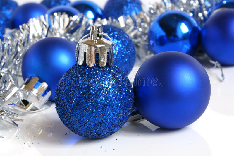 Blue christmas balls. On a white background royalty free stock photography