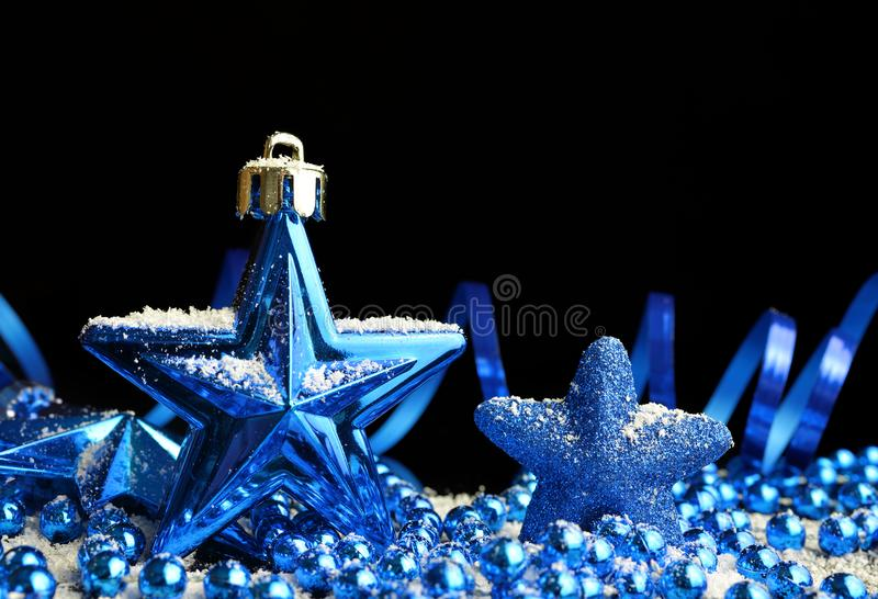 Blue Christmas decorations in the shape star royalty free stock photos