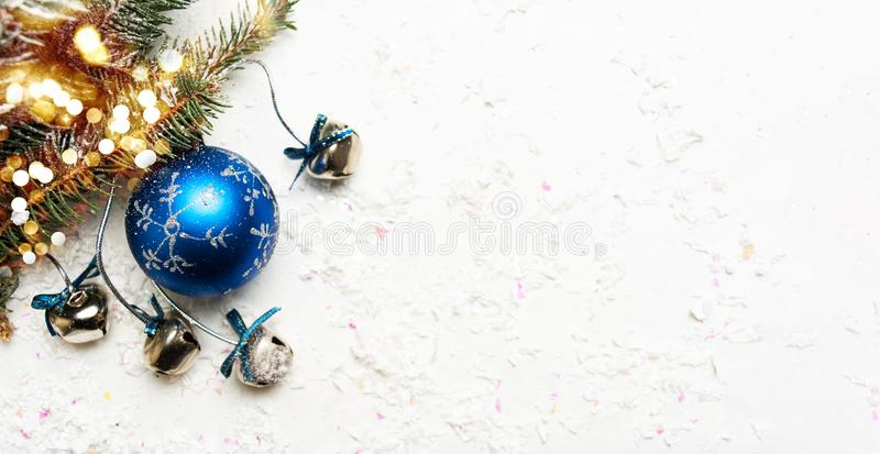 Blue Christmas decorations on snow covered background royalty free stock photography