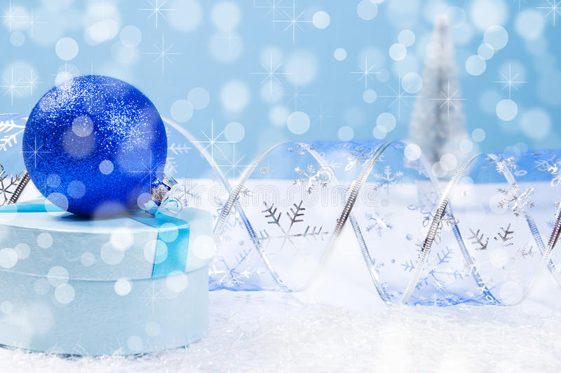Blue Christmas gift box with bokeh background and copyspace royalty free stock image