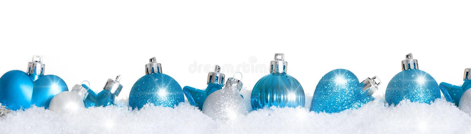 Blue christmas tree balls in snow royalty free stock photo