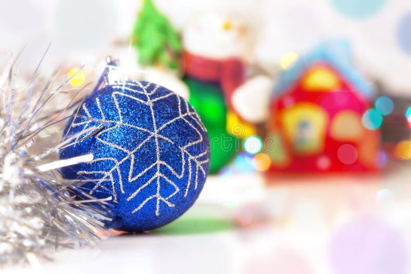 Blue Christmass ball with blury festive glitter lights background stock image