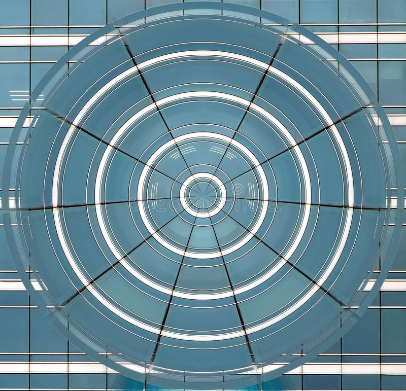 The blue circle of deformed windows stock photography