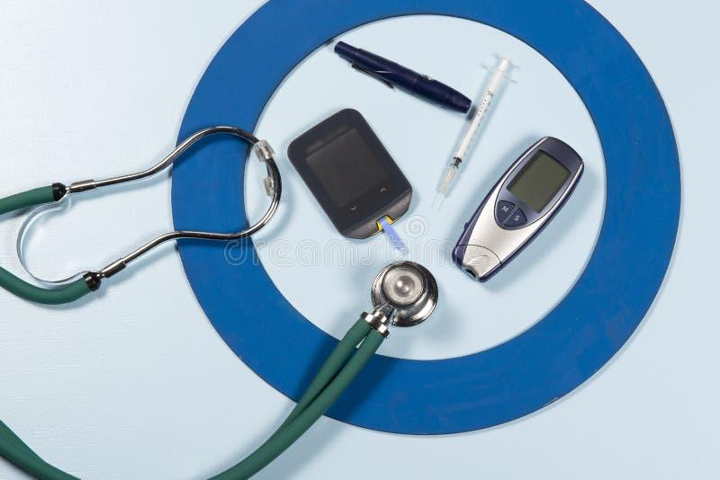 Blue circle with some Diabetes equipment do treatment the disease. Blue circle with some Diabetes equipment do treatment the disease royalty free stock photos