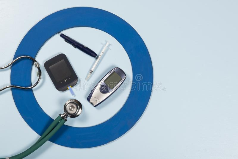Blue circle with some Diabetes equipment do treatment the disease. Blue circle with some Diabetes equipment do treatment the disease, World Diabetes Day royalty free stock photography