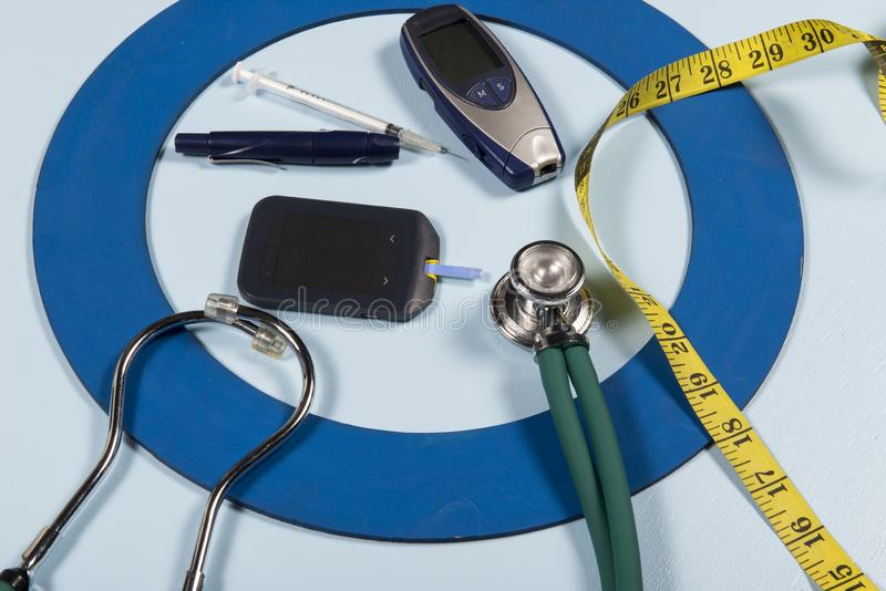 Blue circle with some Diabetes equipment do treatment the disease. Blue circle with some Diabetes equipment do treatment the disease, World Diabetes Day royalty free stock photos
