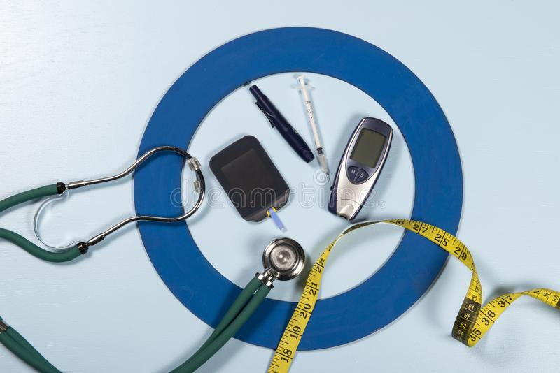 Blue circle with some Diabetes equipment do treatment the disease. Blue circle with some Diabetes equipment do treatment the disease, World Diabetes Day stock photos