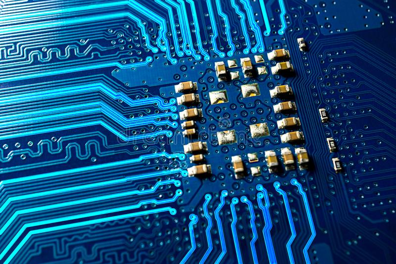 Blue circuit board and glowing line macro photo royalty free stock images