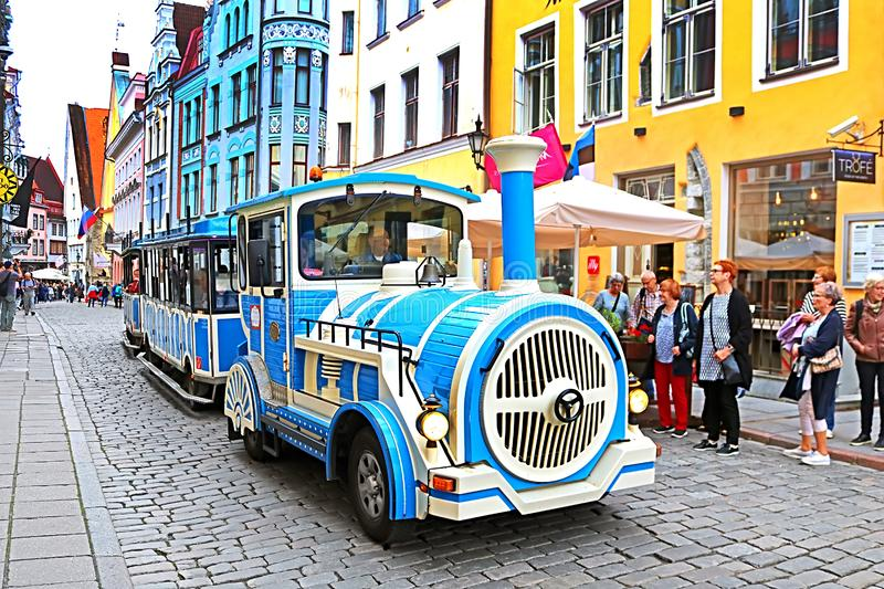 Blue City Train, tourist sightseeing vehicle, is driven through Pikk Steet in the Old Town of Tallinn, Estonia royalty free stock photo