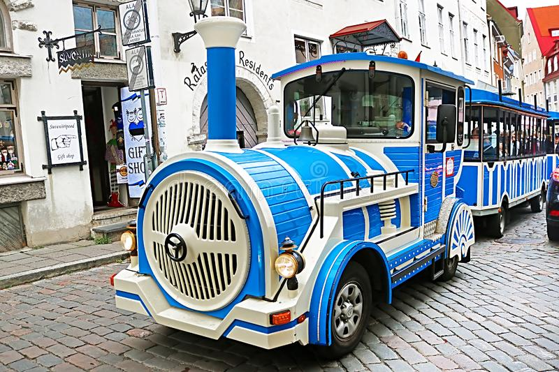 Blue City Train, tourist sightseeing vehicle, is driven through Rataskaevu Steet in the Old Town of Tallinn, Estonia royalty free stock photography