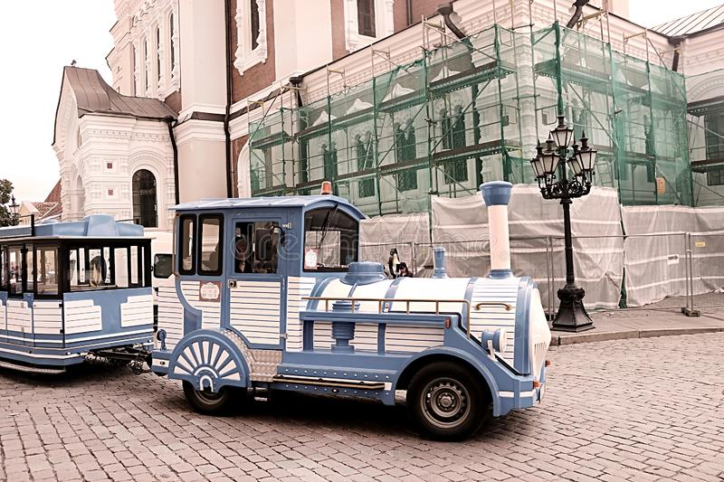 Blue City Train, tourist sightseeing vehicle, is driven through steet near Alexander Nevsky Cathedral in the Old Town of Tallinn stock photos