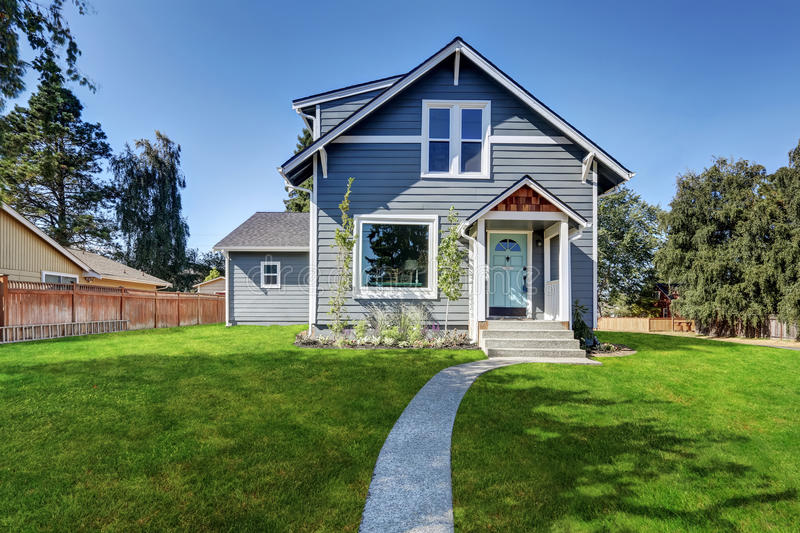 Blue clapboard siding house with grass filled front yard. Northwest, USA royalty free stock images