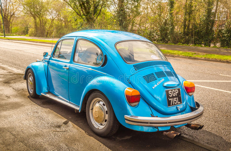 Blue classic car Volkswagen Beetle. Warwickshire, United Kingdom - April 7, 2016: Blue classic car Volkswagen Beetle parked at the street as seen from the rear royalty free stock photo