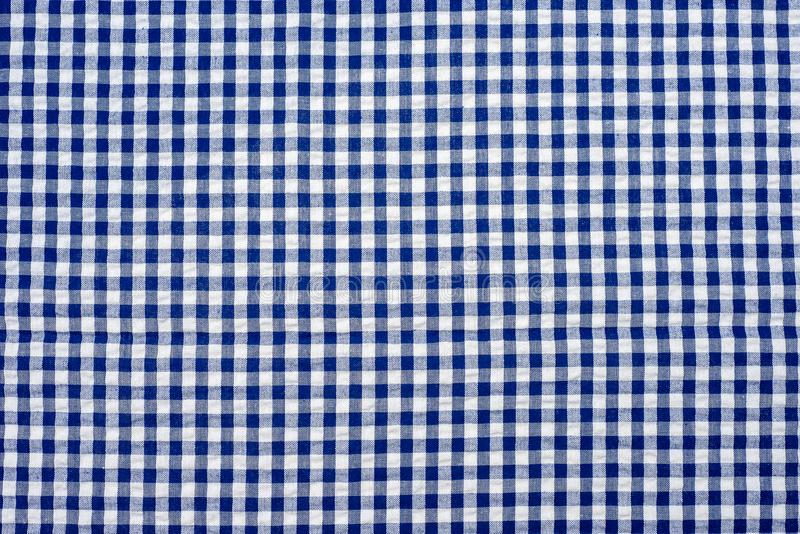 Blue classic checkered tablecloth texture , Cloth in a blue box. royalty free stock photos