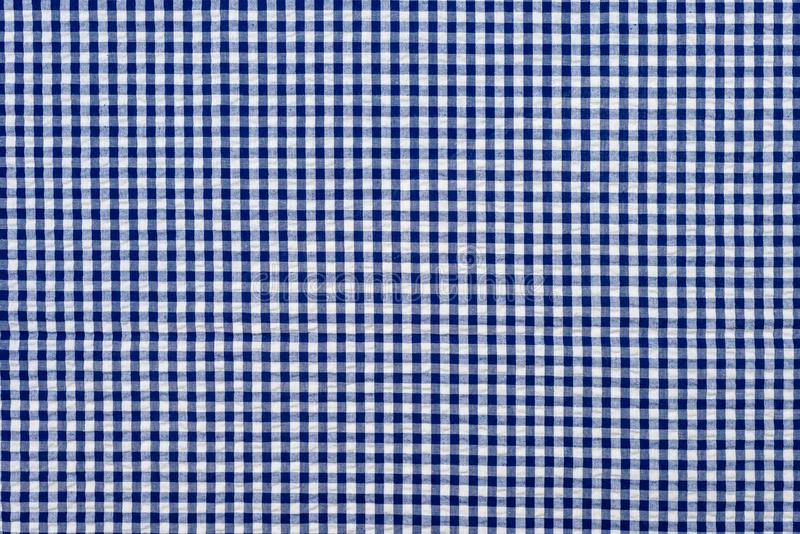 Blue classic checkered tablecloth texture , Cloth in a blue box. royalty free stock photography