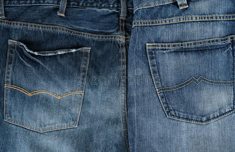 Blue classic jeans folded in a row. Back pocket stock image