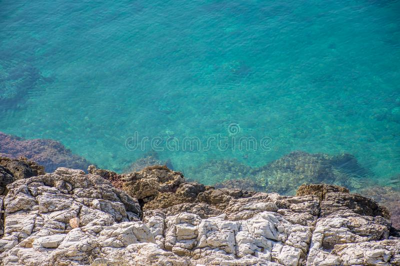Blue clear aegean sea and rocks stock images