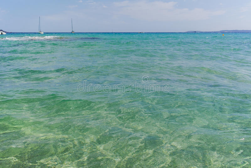 Blue clear sea water Le Lavandou - vacation destination in Franc stock image
