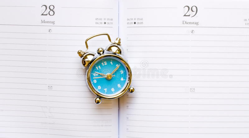 Download Blue clock on agenda stock photo. Image of timetable - 36154980
