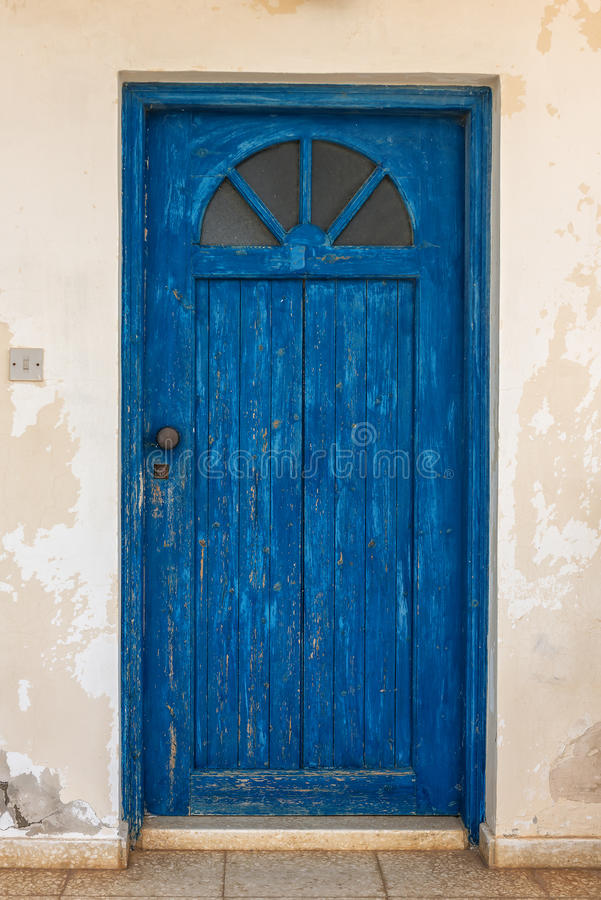 Blue closed door. In the wall stock images