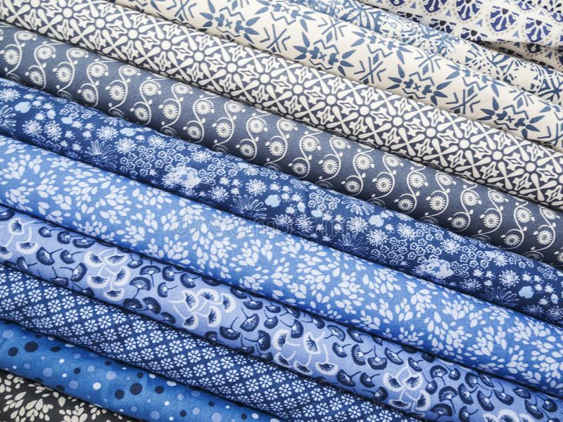 Blue cloth balls for textiles. Full-frame view of different patterned fabric balls in blue of textiles royalty free stock photos