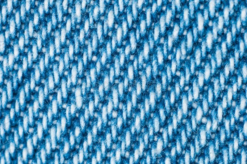 Blue cloth made of thin threads with kitchen cloth for wiping dishes close-up macro shot stock photo