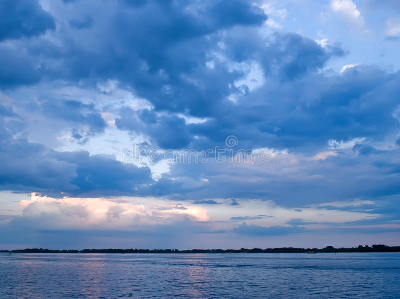 Blue clouded sky over lake stock photos