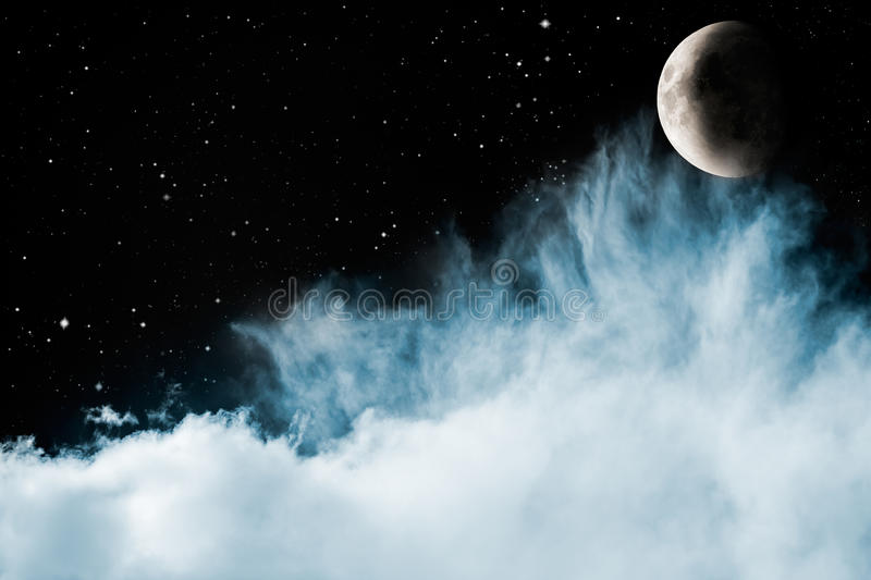 Blue Clouds and Moon royalty free stock photos