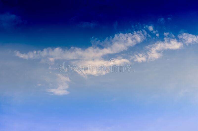 Blue cloudy sky during daytime - a cool picture for backgrounds and wallpapers. A blue cloudy sky during daytime - a cool picture for backgrounds and wallpapers royalty free stock photo