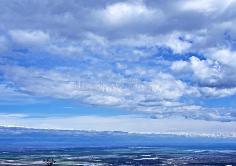 Blue cloudy sky over the Alazani valley in Georgia royalty free stock photos