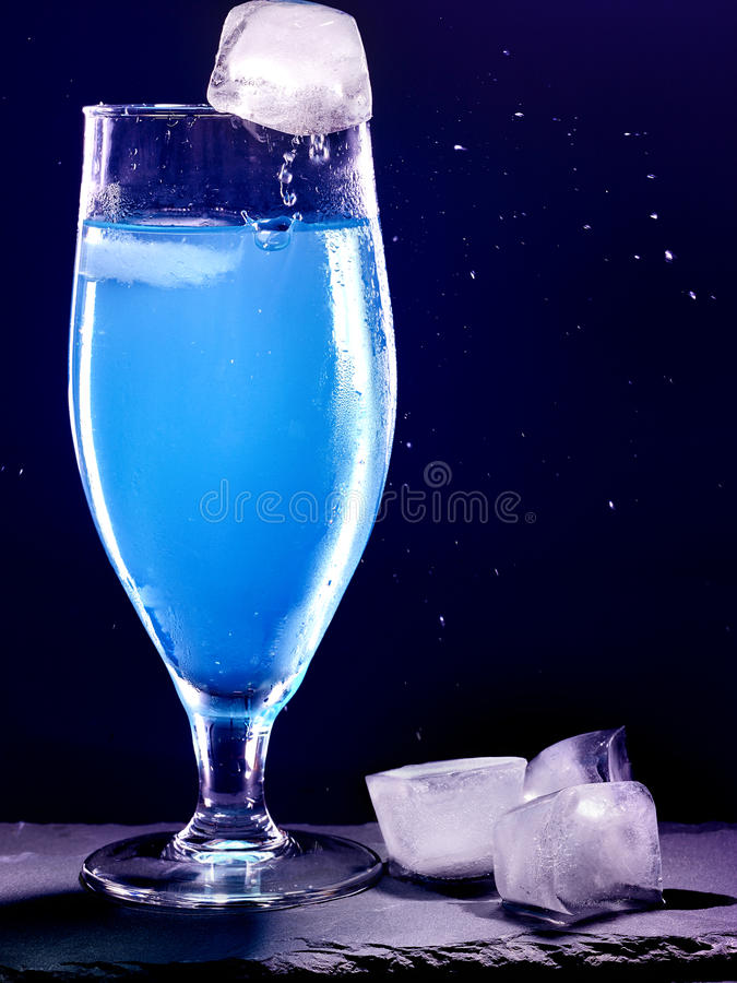 Blue cocktail on black background 9 royalty free stock photography