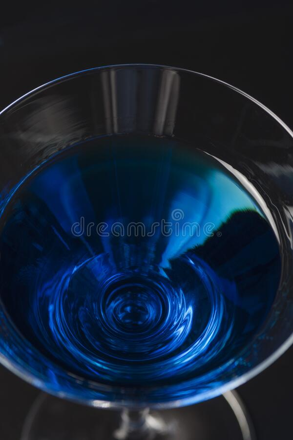 Blue cocktail in a glass. View from above royalty free stock images