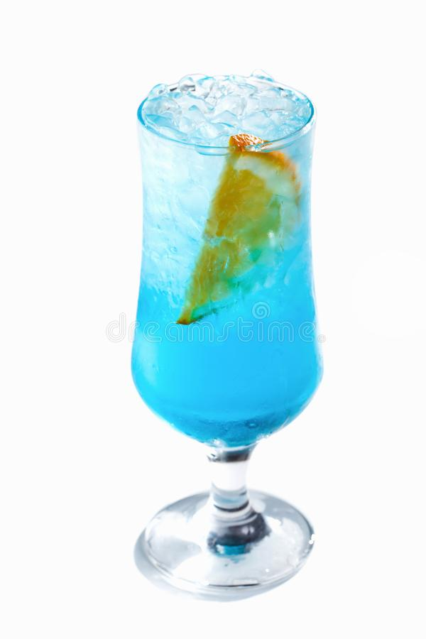 Blue cocktail with ice and orange in a glass on an isolated white background. Blue cocktail with ice and orange in a tall glass on an isolated white background stock photography