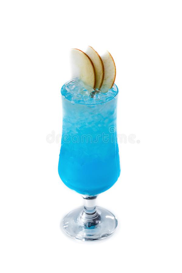 Blue cocktail with ice and pear slices in a glass on an isolated white background royalty free stock photography