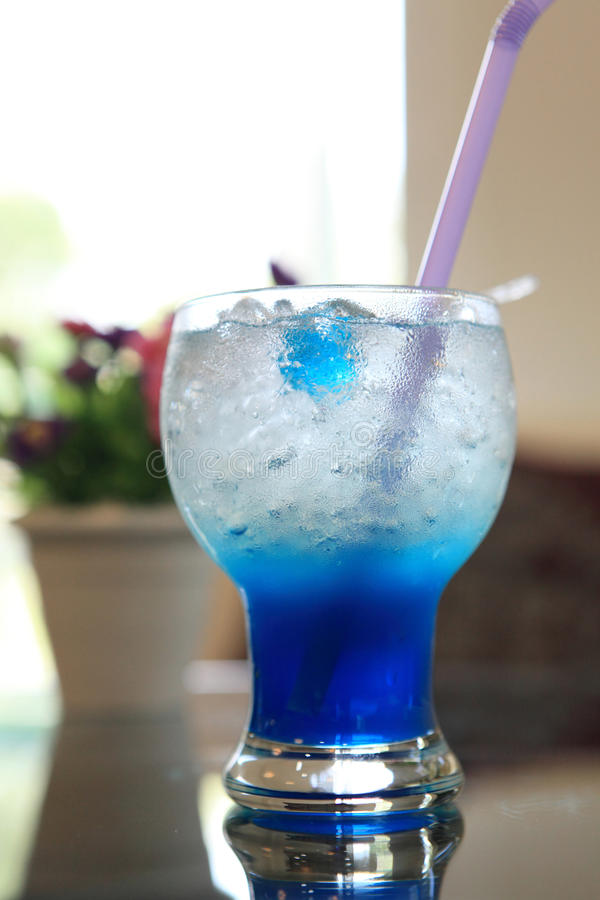 Blue cocktail martini with flower