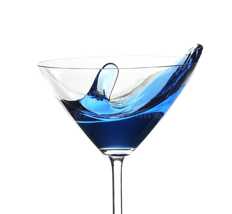 Blue cocktail with splash, isolated on white royalty free stock image