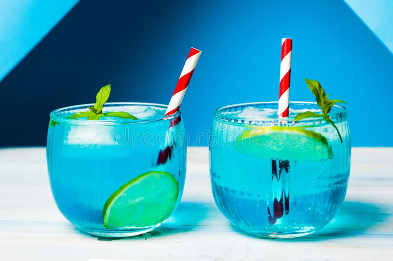 Blue cocktails decorated with lemon stock images
