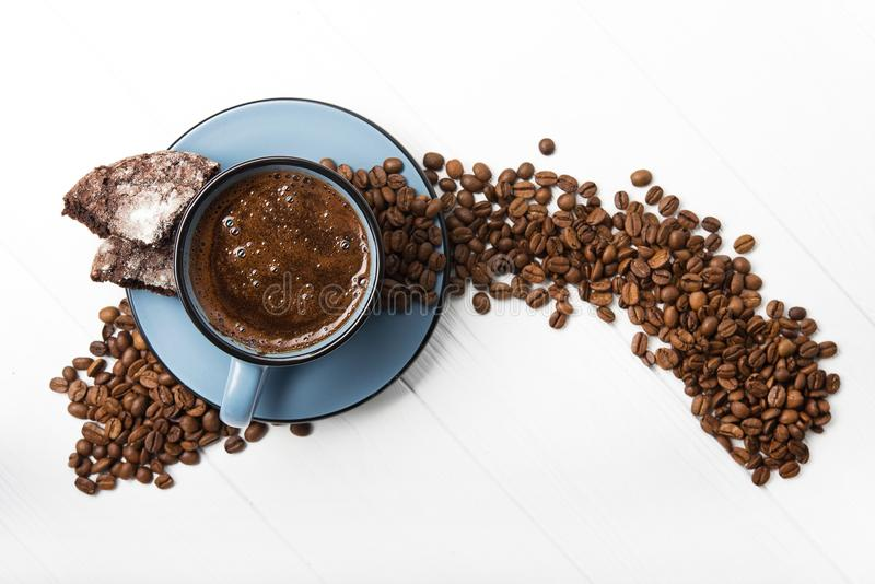Blue coffee cup with chocolate cookie. On a white wooden table. top view stock photography