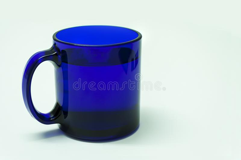 Blue coffee cup isolated on white background. Blue coffee cup close up on white background royalty free stock photography