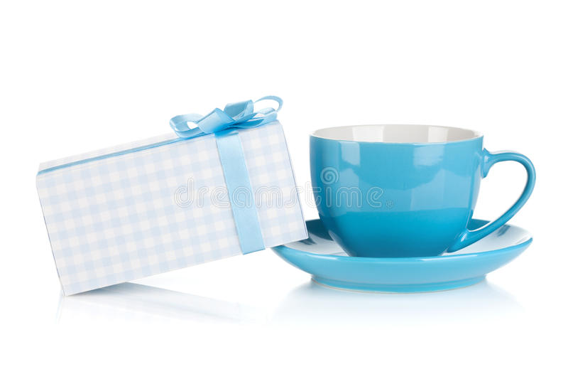 Blue coffee cup and gift box with bow. Isolated on white background royalty free stock photography