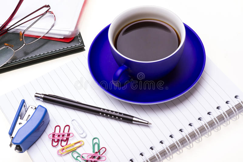 Blue coffee cup, glasses and office supplies. on white. Background stock photography