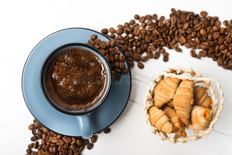 Blue coffee cup with roasted beans. On a wooden table. top view stock photo