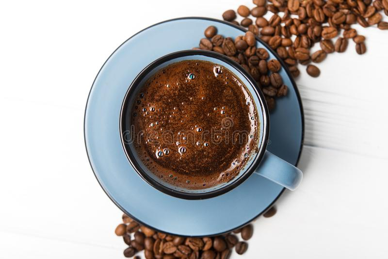 Blue coffee cup with roasted beans. On a wooden table. top view stock photos