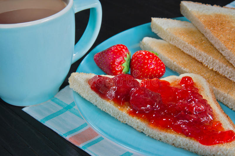 Blue coffee cup and toast. With strawberry jam royalty free stock image