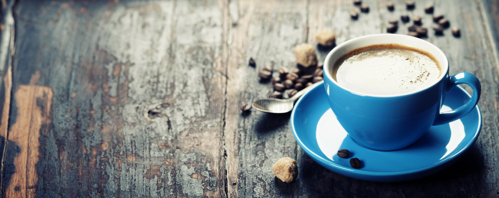 Blue coffee cup. On vintage wooden background royalty free stock photography