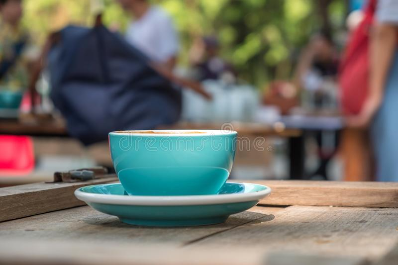 Blue coffee cup on wooden table,Close-up photo of blue coffee cu. P,The back is blurred stock photo