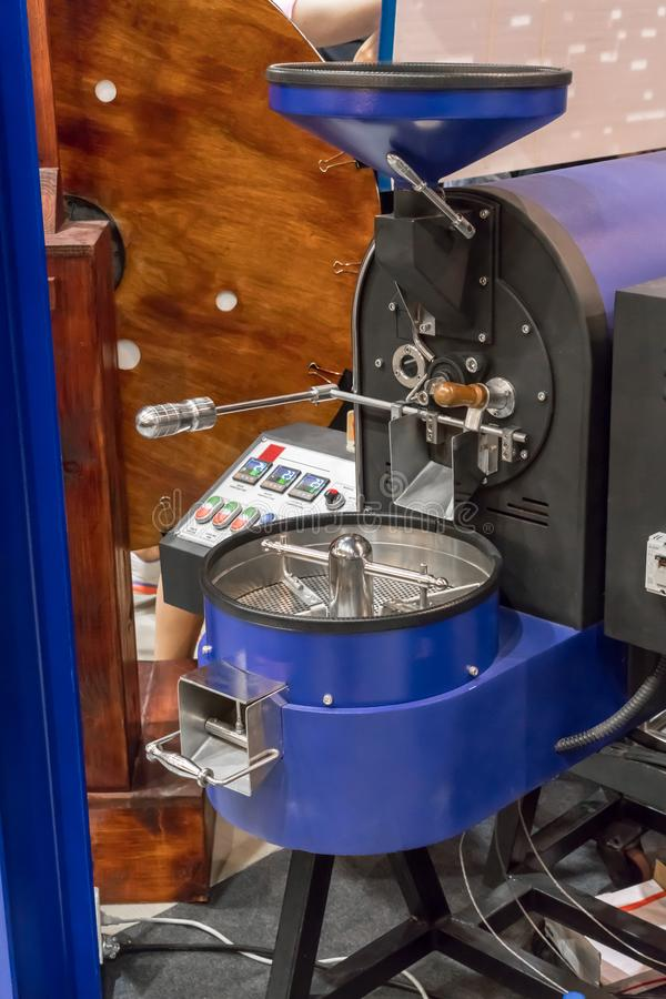 Blue coffee roaster machine with new technolgy and system stock images