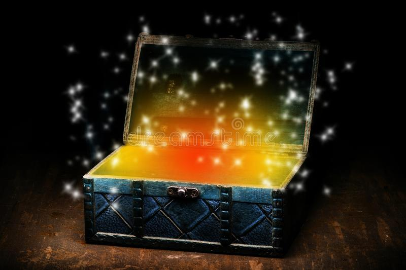 Blue coffer with orange gleam and sparkling lights. Opened coffer with magic sparkling lights and orange energy